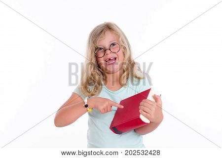 Blond Girl With Round Glasses Pointing At Red Book