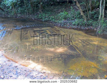 Riverbed carving at The River of a Thousand Lingas Kbal Spean Khmer relics in Angkor temple area in Cambodia
