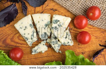 Cheese With Mold On Rustic Background