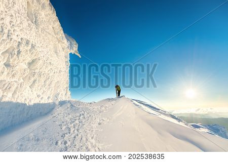 People On The Top Of The Winter Mountain