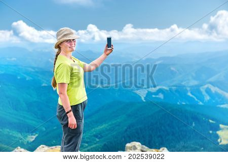 Young Woman Taking Selfie On Smartphon