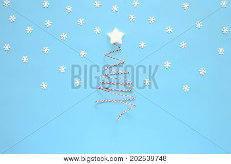 Christmas tradishional bicoloured decorative twine set up in Christmas tree shape simple cute winter holidays concept flat lay space for a greeting text