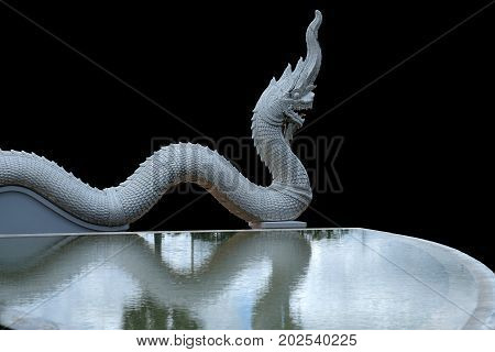 rock monster, the guardian snake 'NAKA or NAGA' who protected Buddha and people from devil
