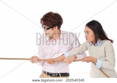 Asian business executives pulling tug, isolated on white