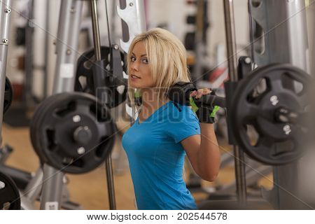 Bodybuilding. Strong Fit Woman Exercising With Barbell. Girl Lifting Weights In Gym