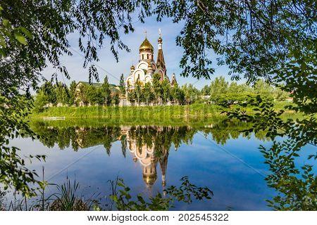 Christian church near Almaty Kazakhstan reflected in lake