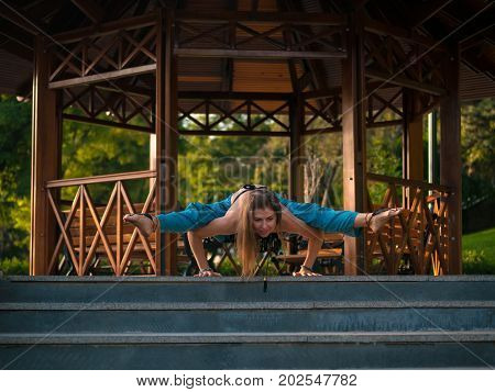 Yoga, Morning with woman wearing alladin pants, beautiful model health care show yoga, healthy slender is smile on the garden, girl yoga meditation, wooden alcove background