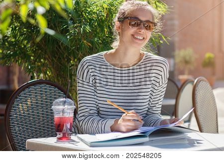 Outdoor Closeup Of Good-looking European Girl In Trendy Sunglasses Laughing And Looking Excited And