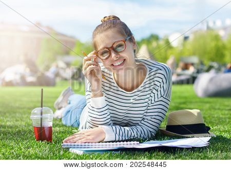 Bright Summer Closeup Of Smiling European Student Girl In Trendy Eyeglasses Looking Straight At Came