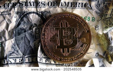 Bitcoin On Crushed Dollar Banknote