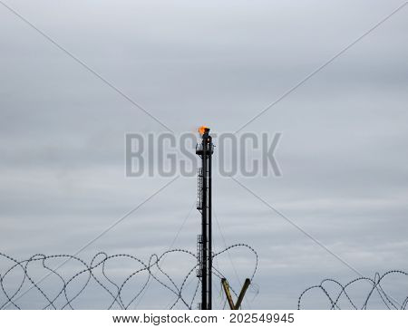 Torch System On An Oil Field. System Of A Torch On An Oil Field. Burning Through A Torch Head.