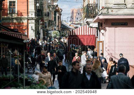 Lviv Ukraine - September 23 2016: Crowd of tourists on Galytska Street in Old Town close to Rynok Square Market Square in Lviv Ukraine.