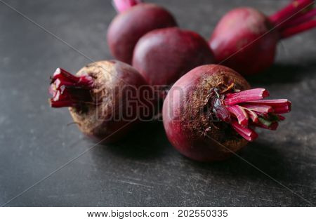 Delicious ripe beets on dark background