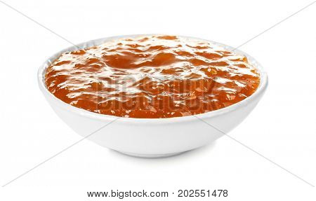 Apricot jam in bowl, isolated on white