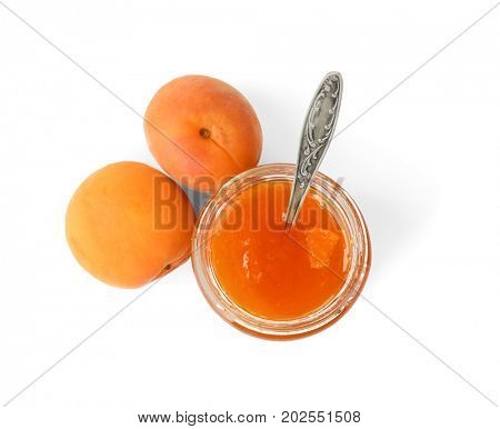 Apricot jam in jar with spoon and fresh fruit isolated on white
