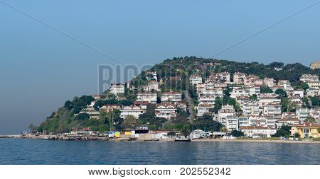 Istanbul, Turkey - April 27, 2017: View of Kinaliada island from the sea with summer houses. One of four islands named Princes Islands in the Sea of Marmara near Istanbul Turkey