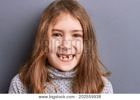 Studio portrait of smiling little girl. Close up portrait of pretty little smiling girl. Kids expressions of happiness.