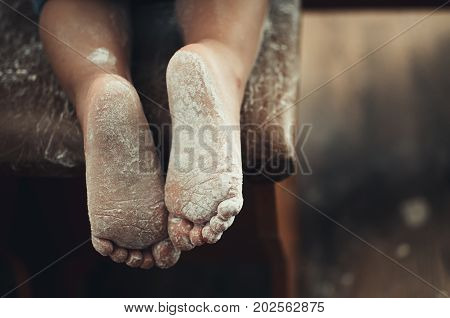 The Legs Of A Small Child In The Flour Very Cute