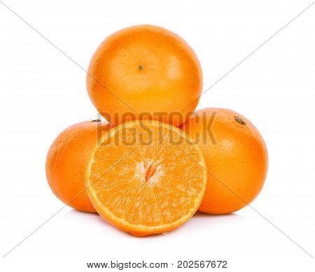 whole and half of fresh mandarin oranges isolated on white background