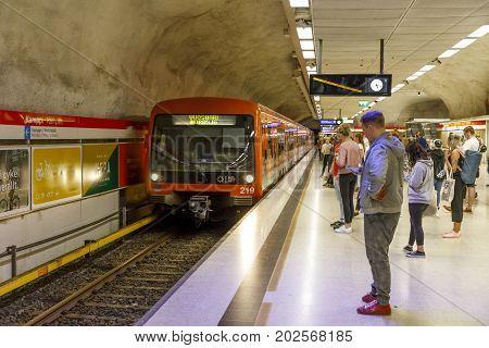 HELSINKI FINLAND - AUGUST 13 2017: People wait for the metro in Kamppi underground station in Helsinki Finland on August 13 2017