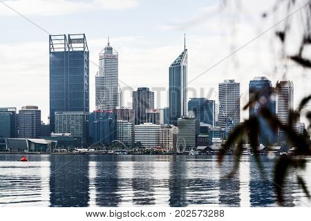 The buildings of the Perth city skyline surrounded with low clouds. Perth, Western Australia, Australia. August 29th, 2017.