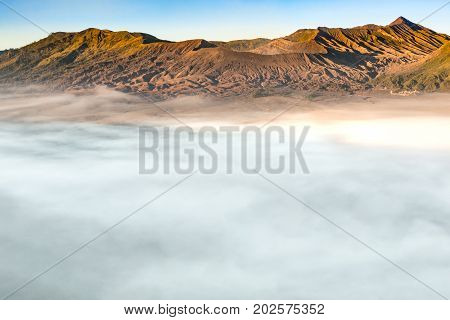 The landscapes of Mount Bromo volcano (Mt.) with daylight toned and sea mist located in Bromo Tengger Semeru National Park East Java Indonesia.