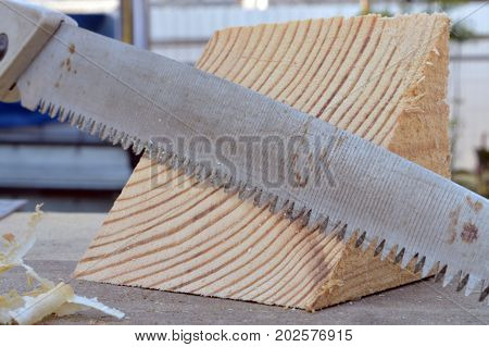 Saw And Wooden Shavings On The Boards