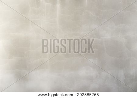 Blurred empty beige marble wall in cracks