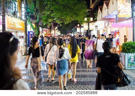 Guilin, China - June 11, 2017: People In The Zhengyang, Famous Walking Street, Visited By Many Local
