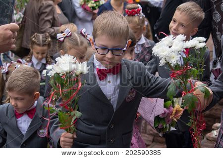 Makeevka Ukraine - September 1 2017: First-graders go to the first lesson in school on the territory controlled by the separatists