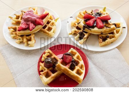 Viennese Waffles With Strawberries And Chocolate On The Plate