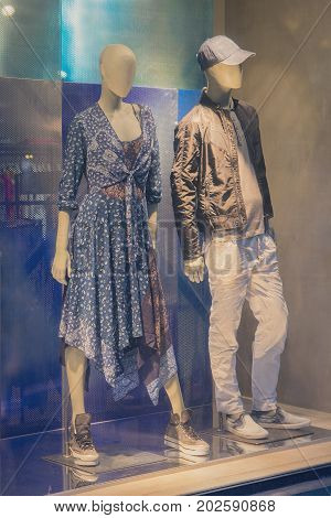 Male and female mannequins in the window. Fashion