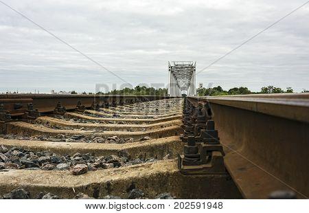 Rails and railway sleepers and railway bridge