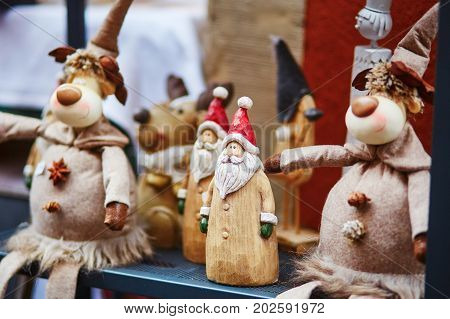 Wooden Santa And Funny Deers On Traditional Christmas Market In Strasbourg