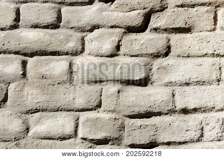 Wall of old gray plastered brickwork pattern
