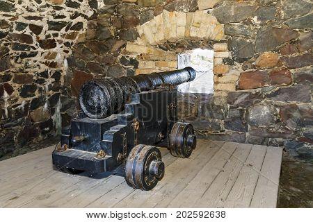 Old cannons in Suomenlinna fortress area in Helsinki Finland