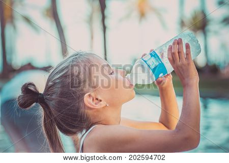 A Child Is Drinking Clean Water From A Bottle. Hot Summer Day.