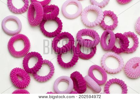 Bright pink fashion girly hair accessories. Little girl girlie feminine fashion style. Teenager hair ribbons pink cute girlie stuff