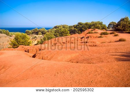 Red soil in a quarry of bauxite Apulia in Italy
