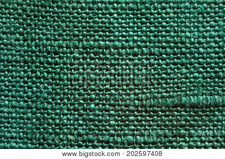 Texture of green linen cloth. Fabric texture background