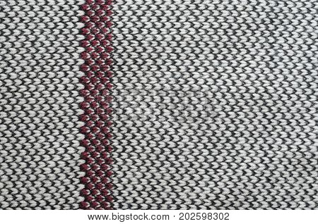 Knitting fabric texture closeup background - black beige burgundy color