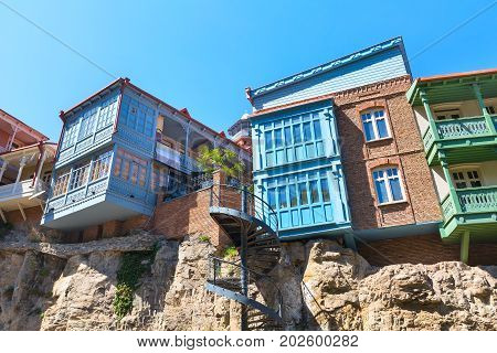 Tbilisi, Georgia - April 24, 2017: houses with traditional wooden carving balconies of Old Town of Tbilisi, Republic of Georgia