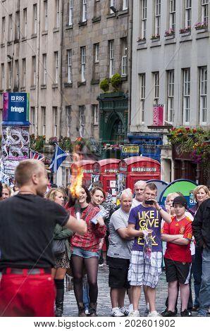 Edinburgh Scotland - August 9 2010: Group of people watching a street artist during the Fringe Festival in Edinburgh Scotland