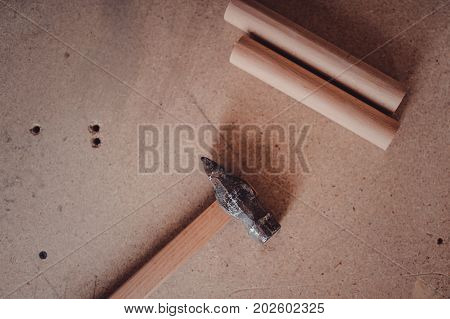 Carpenters Tools Background. A Hammer Lying On A Carpenters Table With Furniture Details