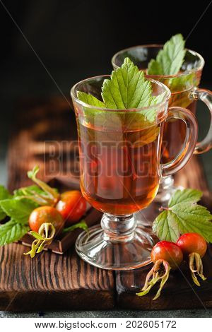 Rosehip Tea In Glass On Black Stone Background