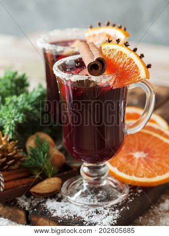 Glasses Of Punch For Winter And Christmas With Fruits And Wine