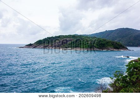 view of andaman sea with mountain and sky background