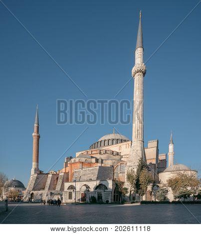 ISTANBUL TURKEY - NOVEMBER 18 2013: People visiting the historical area of Sultanahmet Istanbul. The famous landmark Hagia Sophia