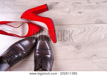 Men's And Red High Heel Womens Shoes On White Background