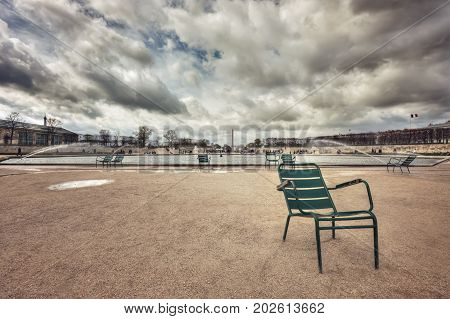 A chair near the Grand Bassin Octogonal in Jardin des Tuileries. France. Paris